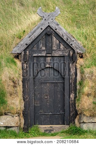 An Icelndic turf home door made of wood