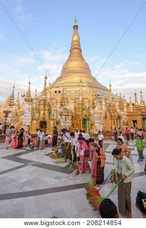 17 december 2016 Shwedagon pagoda yangonmyanmar buddhist people clean up the pagoda floor at Shwedagon Pagoda in Yangon Myanmar