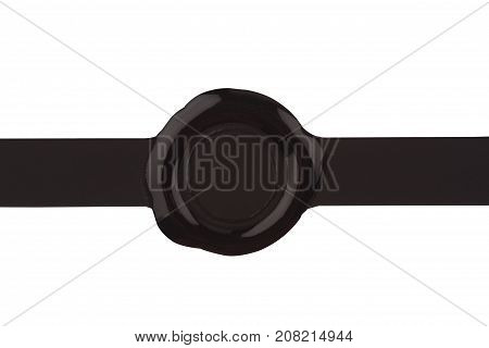 top view of empty black wax plastic seal with gold foil and copyspace isolated on white background