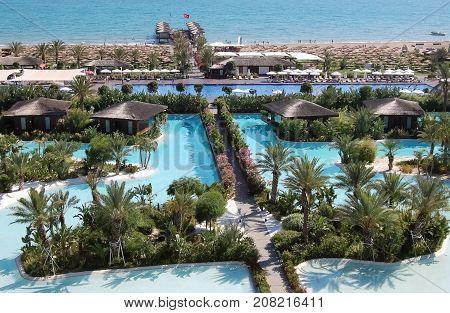 Belek Turkey - June 01 2015: View of the beach line and territory with pools of the luxury hotel Maxx Royal Belek Golf Resort.