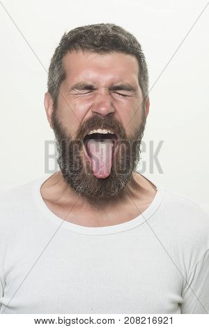 Man With Long Beard With Closed Eyes And Tongue
