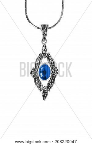 Vintage silver pendant with blue sapphire on white background