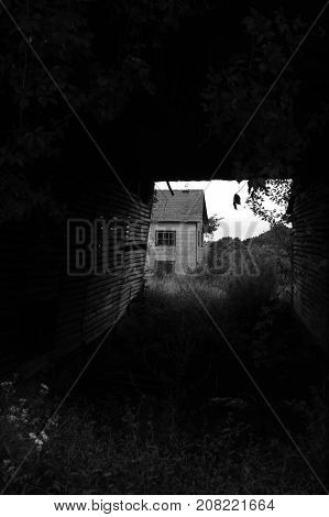 Looking through an old structure at an old house