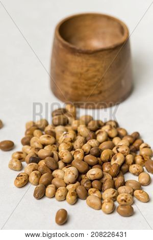 Soya Beans With Wooden Pot On The White Marble Background