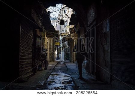 Tripoli, Lebanon - October 9 2015: Women Walking In The Dark Streets Of The Souks Of Tripoli