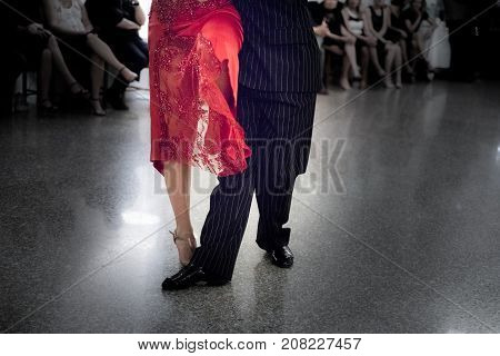 Detail of tango dancers in milonga ballroom