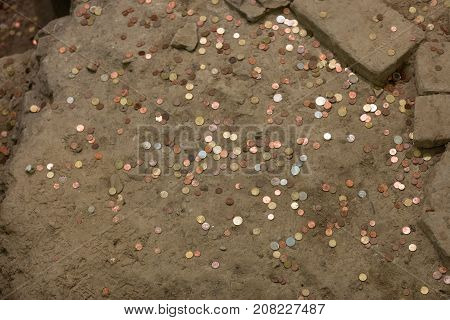 pennies on offer in the ground in a church
