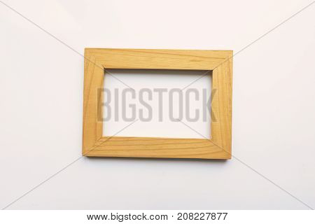 Wooden rectangular photo frame on white background