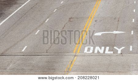 only right road sign marked on asphalt