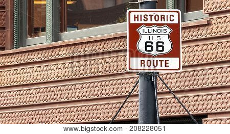historical Route 66 sign in Chicago in a sunny day