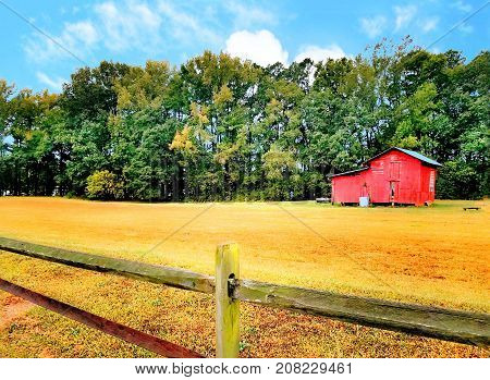 A nice red barn out on a farm.