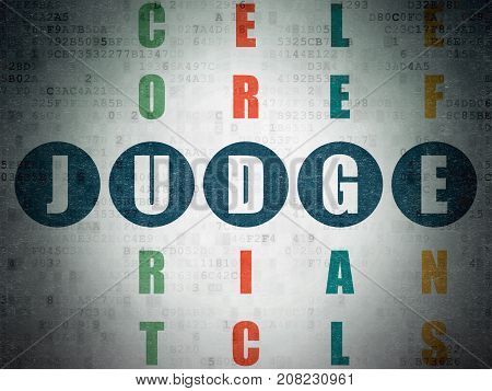 Law concept: Painted blue word Judge in solving Crossword Puzzle on Digital Data Paper background