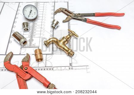 Plumbing Tools Arranged On House Plans whit wrench and water valves