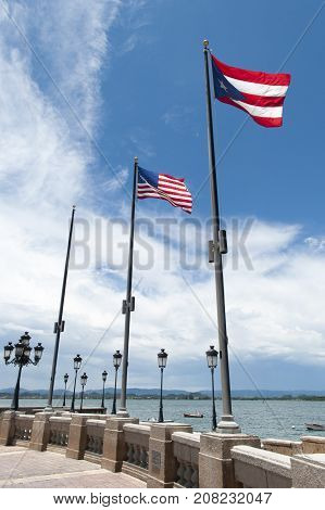 Flags of Puerto Rico and the United States in the old town of San Juan.