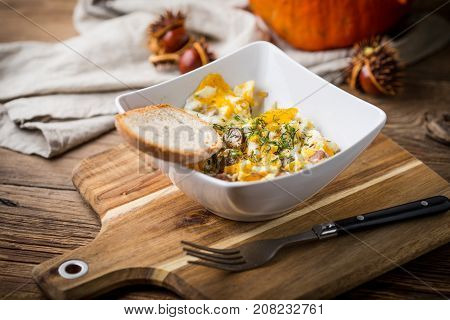 Scrambled Eggs With Sausage And Bread.