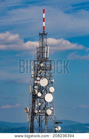 Telecommunication mast on a hill in the Jizera Mountains.