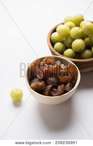Stock photo of dried sweet and salty or chatpata Amla/Avla/Aavla called murabba, muramba or candy, selective focus