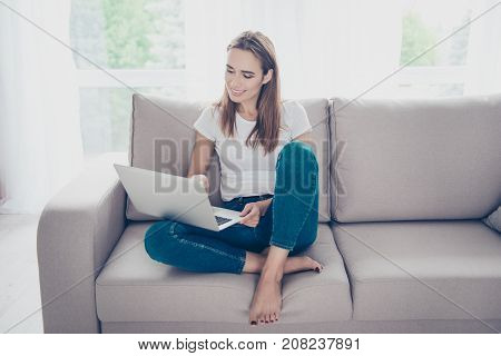 Serene Gorgeous Brown Haired Student On The Beige Couch At Home Studying, Chilling, So Comfortable,
