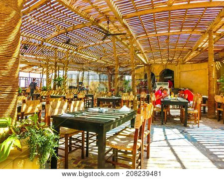 Sharm El Sheikh, Egypt - September 25, 2017: The people resting at outdoor restaurant and beach at the luxury hotel at Sharm el Sheikh, Egypt on September 25, 2017