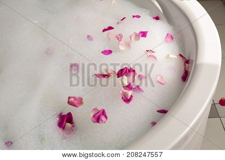 pink rose petals in the bubble bath
