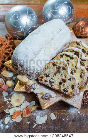 Traditional German Christmas Raisins And Dried Fruits Cake With Sugar Powder And Christmas Decoratio