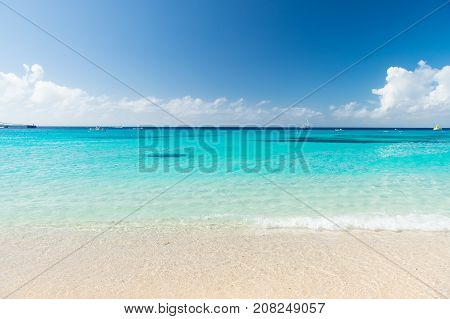 sea. Beautiful white clouds on blue sky over calm sea with sunlight reflection bali . Tranquil sea harmony of calm water surface. Sunny sky and calm blue ocean. Vibrant sea with clouds on horizon