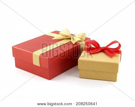 close-up two gift boxes (yellow gold box with red ribbon bow and red box with golden ribbon bow) isolated on white background