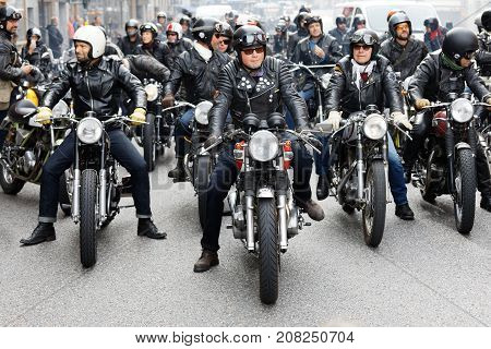 STOCKHOLM SWEDEN - SEPT 02 2017: Group of tough bikers in leather clothes on retro motorcycles at the Mods vs Rockers event at the Saint Eriks bridge Stockholm Sweden September 02 2017