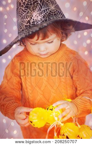 Little Kid With Halloween Decorations.
