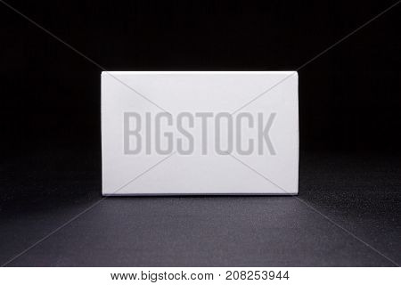 White boxes. Mockup ready for your design. Box perspective. Dark blue background.