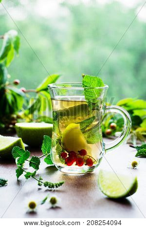 Green tea with lime and chamomile berries. A fragrant and delicious drink. Oriental tea. Mint tea