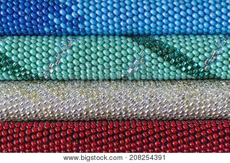 A colorful background of plastic beads background of beads