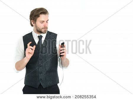 Businessman in headset with cell phone. Guy listen to music. Music and relax. Audio book and new technology. Man with mp3 player isolated on white background copy space
