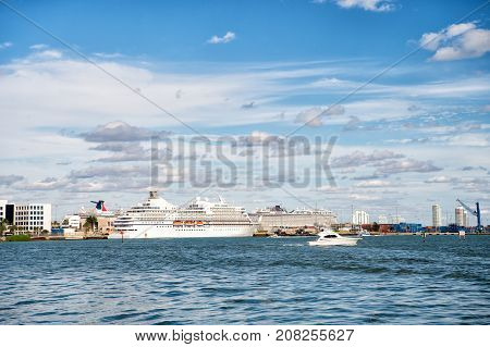 Miami USA - February 29 2016: luxury white sea or ocean liner cruise ship at city harbor or port on sea water surface or moorage on sunny day on blue sky