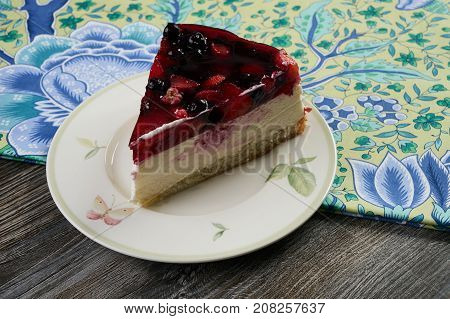 Slice Of Delicious Tasty Cheesecake With Berry