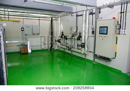 The Interior Of A Modern Industrial Gas Boiler Room. Pipelines, Water Pumps, Valves, Manometers.