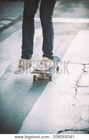 Skateboarder Legs Riding Skateboard On The Street