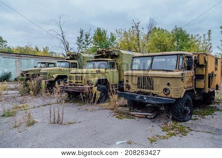 Derelict military trucks in abandoned military base
