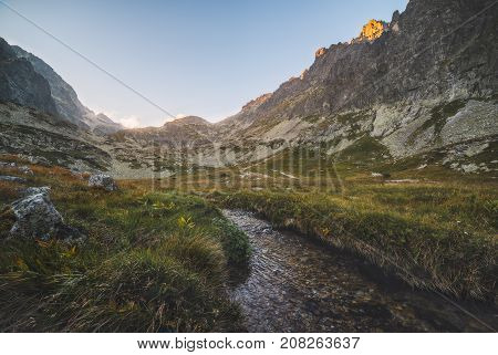 Creek in the Valley under the Mountain Peaks at Sunset. Velicka Valley High Tatra Slovakia.