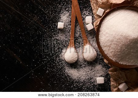 Wooden Bowl And Spoon Full Of Sugar