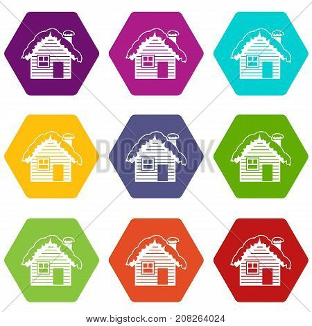 Wooden house covered with snow icon set many color hexahedron isolated on white vector illustration