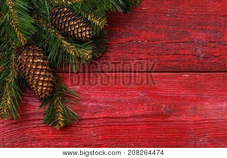 Christmas table place setting - red table with christmas pine branches. Christmas holidays background.