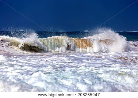 Powerful wave and surf on the coast of the ocean