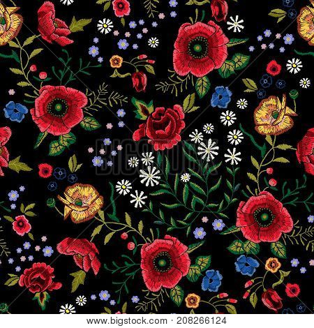 Embroidery traditional seamless pattern with red poppies and roses. Vector embroidered floral patch with flowers for clothing design.