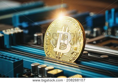 Gold coin of crypto currency Bitcoin on computer network chip, toned