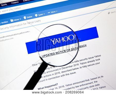 MONTREAL CANADA - OCTOBER 9 2017 : Yahoo updated Notice of data breach under magnifying glass. Yahoo is a web services provider wholly owned by Verizon Communications through Oath Inc.
