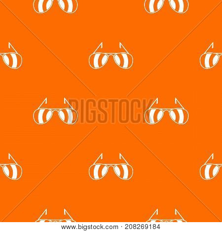 Sunglasses pattern repeat seamless in orange color for any design. Vector geometric illustration