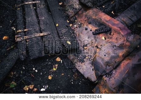 Destroyed by fire wooden door of burned house