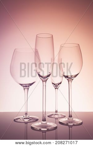 Glassware Selection With Wine, Champagne And Liquour Glasses  On Creative Background