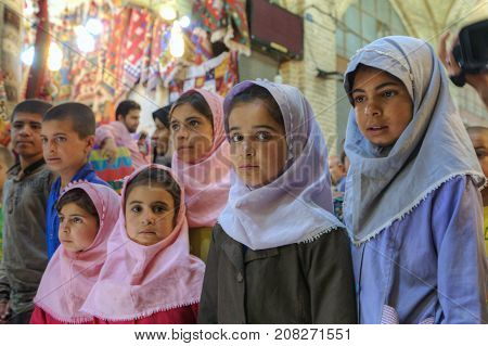 Fars Province Shiraz Iran - 19 april 2017: A group of Iranian children of primary school age visited the Vakil bazaar.